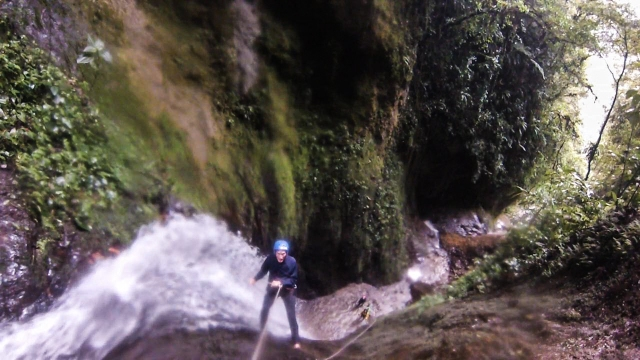 Canyoning down a 25 metre descent